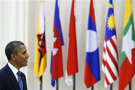 U.S. President Barack Obama passes in front of ASEAN members flags as he arrives for the Plenary session of the 21st ASEAN (Association of Southeast Asian Nations) and East Asia summits in Phnom Penh November 20, 2012. REUTERS/Damir Sagolj
