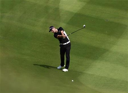 Martin Kaymer of Germany hits a shot on the ninth fairway during the third day of the WGC-HSBC Champions Tournament at Mission Hills in the southern Chinese city of Dongguan November 3, 2012. REUTERS/Bobby Yip