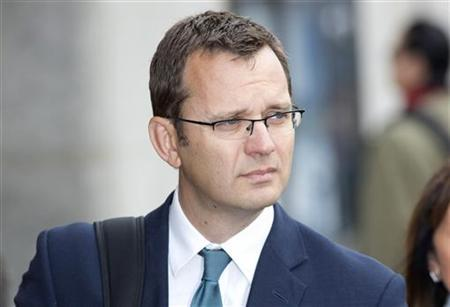 Former News of the World editor Andy Coulson arrives for a hearing at the Old Bailey court in London September 26, 2012. REUTERS/Neil Hall/Files