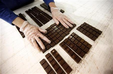 A worker checks the chocolates on a production line at Konya Seker Sugar Factory in Cumra, a small town about 50km (31 miles) south of the central Anatolian city of Konya January 27, 2012. REUTERS/Umit Bektas/Files