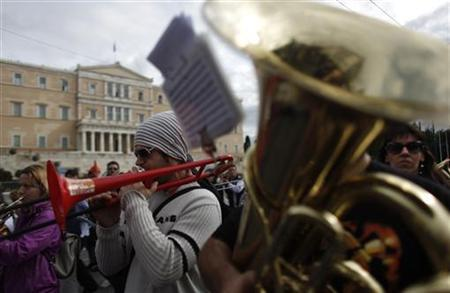 Municipality workers play musical instruments as they march in front of the parliament during a rally against state sector layoffs demanded by the country's international lenders, in Athens November 20, 2012. REUTERS/John Kolesidis