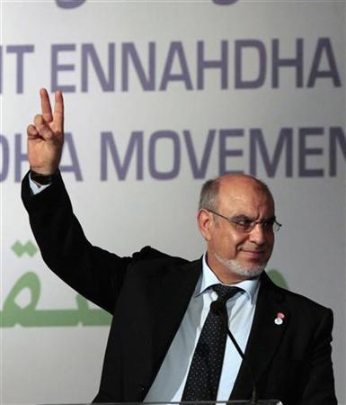 Tunisian Prime Minister Hamadi Jebali flashes the victory sign during the congress of the Ennahda party in Tunis July 12, 2012. REUTERS/Zoubeir Souissi