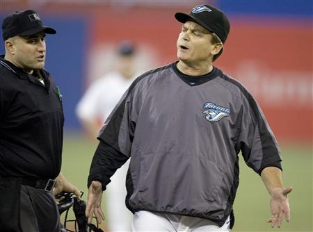 Toronto Blue Jays manager John Gibbons (R) stands on the field during their MLB baseball game against the New York Yankees in Toronto May 31, 2007. REUTERS/Fred Thornhill