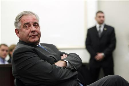 Former Croatian Prime Minister Ivo Sanader sits at a county court in Zagreb November 20, 2012. REUTERS/Antonio Bronic