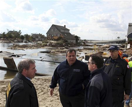 Governor Chris Christie (2nd L) surveys the Hurricane Sandy damaged areas along Rt 35 in Bayhead, New Jersey, November 2, 2012 in this handout image courtesy of the governor's office. REUTERS/New Jersey Governor's Office/Tim Larsen/Handout