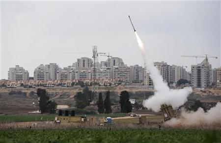 An Iron Dome launcher fires an interceptor rocket near the Israeli city of Ashkelon November 19, 2012. REUTERS/Darren Whiteside