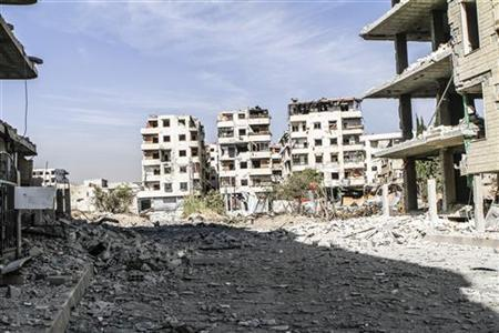 Damaged buildings are seen after an air strike by Syrian President Bashar al-Assad's forces at the Hammouriyeh area in Ghouta east of Damascus November 17, 2012. REUTERS/Omar al-Khani