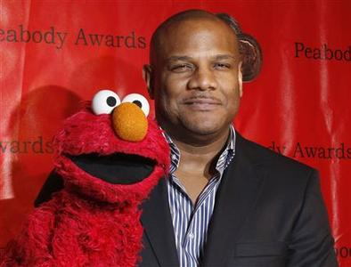 Voice actor Kevin Clash arrives with the puppet Elmo for the 2010 Peabody Award ceremony at the Waldorf Astoria in New York in this May 17, 2010 file photo. REUTERS/Lucas Jackson/Files