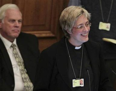 Reverend Canon Jane Charman speaks at the Assembly Hall of Church House, during a meeting of the General Synod of the Church of England in London November 20, 2012. The Church of England decides on Tuesday whether to allow the ordination of women bishops when members take part in an historic vote whose result could prove the first major test for the next archbishop. REUTERS/Yui Mok/POOL