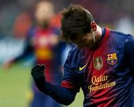 Lionel Messi marcó el martes un doblete en el primer tiempo en la victoria 3-0 del Barcelona sobre el Spartak de Moscú, clasificándose para octavos de final de la Liga de Campeones. En la imagen, el jugador del Barcelona Lionel Messi celebra su gol contra el Spartak de Moscú en su partido del Grupo G de Liga de Campeones en el estadio Luzhniki de Moscú, el 20 de noviembre de 2012. REUTERS/Grigory Dukor