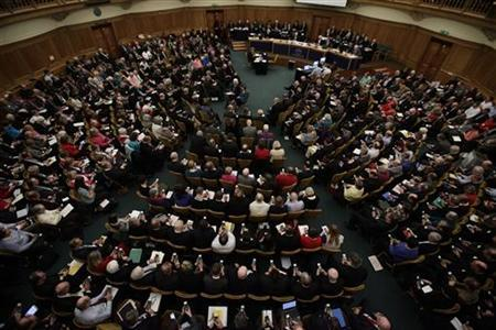 Members vote on handsets to decide whether to give final approval to legislation introducing the first women bishops, during a meeting of the General Synod of the Church of England in London November 20, 2012. REUTERS/Yui Mok/POOL