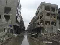 Buildings damaged after shelling by forces loyal to Syria's President Bashar al-Assad are seen at Douma near Damascus November 19, 2012. REUTERS/Abed Al-Kareem Muhammad/Shaam News Network/Handout