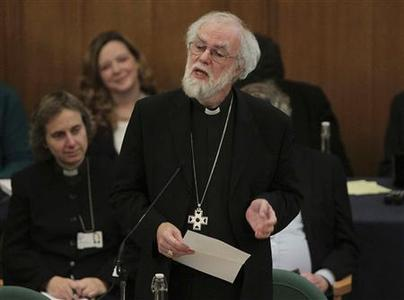 The outgoing Archbishop of Canterbury Rowan Williams speaks at the Assembly Hall of Church House, during a meeting of the General Synod of the Church of England in London November 20, 2012. REUTERS/Yui Mok/POOL