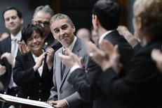 Quebec's Minister of Finance Nicolas Marceau acknowledges the applause as he tables his provincial budget at the National Assembly in Quebec City, November 20, 2012. REUTERS/Jacques Boissinot/Pool