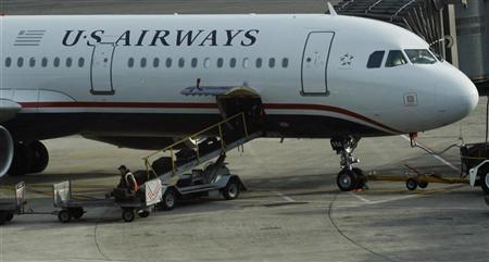 A worker is seen loading luggage on a plane from US Airways at Newark Liberty International Airport in Newark, New Jersey November 15, 2012. REUTERS/Eduardo Munoz