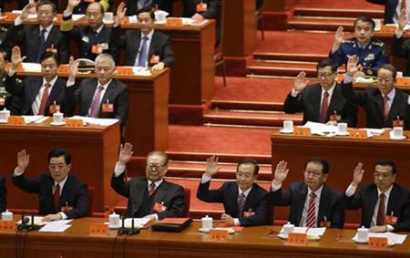 (Front row, L to R) China's President Hu Jintao, China's former President Jiang Zemin, China's Premier Wen Jiabao, Standing Committee of the Political Bureau member Li Changchun and China's Vice-Premier Li Keqiang raise their hands as they take a vote at the closing session of 18th National Congress of the Communist Party of China, at the Great Hall of the People in Beijing, November 14, 2012.REUTERS/Jason Lee