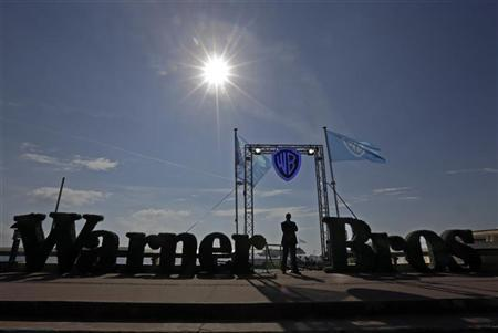 A security guard stands at the entrance of the Warner Bros beach during the annual MIPCOM television programme market in Cannes, southeastern France, October 8, 2012. REUTERS/Eric Gaillard