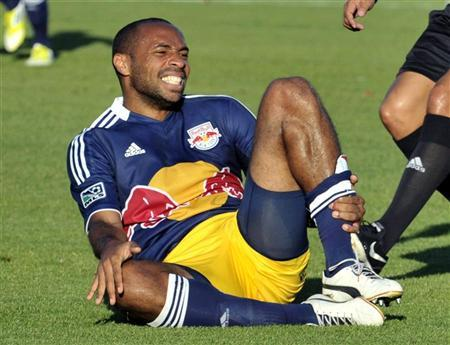 New York Red Bulls' Thierry Henry grabs his leg after a collision during the first half of their MLS soccer match against Toronto FC in Toronto June 30, 2012. REUTERS/Mike Cassese