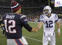 New England Patriots quarterback Tom Brady (L) shakes hands with Indianapolis Colts quarterback Andrew Luck at the conclusion of the fourth quarter of their NFL football game in Foxborough, Massachusetts November 18, 2012. REUTERS/Jessica Rinaldi