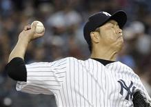 New York Yankees starting pitcher Hiroki Kuroda throws a pitch to the Boston Red Sox in the first inning of their MLB American League game at Yankee Stadium in New York July 29, 2012. REUTERS/Ray Stubblebine