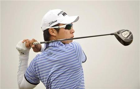 Choi Jin-ho of South Korea watches his shot during the third round of the Volvo China Open at Binhai Lake Golf Club in Tianjin municipality, April 21, 2012. REUTERS/Paul Lakatos/OneAsia/Handout