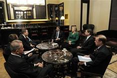U.S. Secretary of State Hillary Clinton meets with U.N. Secretary-General Ban Ki-Moon (rear L) at a hotel in Jerusalem November 21, 2012. Israeli air strikes shook the Gaza Strip and Palestinian rockets struck across the border as Clinton held talks in Jerusalem in the early hours of Wednesday, seeking a truce that can hold back Israel's ground troops. REUTERS/U.N. Photo/Evan Schneider/Handout (ISRAEL - Tags: POLITICS CONFLICT MILITARY) FOR EDITORIAL USE ONLY. NOT FOR SALE FOR MARKETING OR ADVERTISING CAMPAIGNS. THIS IMAGE HAS BEEN SUPPLIED BY A THIRD PARTY. IT IS DISTRIBUTED, EXACTLY AS RECEIVED BY REUTERS, AS A SERVICE TO CLIENTS