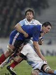 """<p>Louis Picamoles (en bleu) lors du match contre l'Argentine, battue 39-22 à Lille. Face à l'Australie d'abord, l'Argentine ensuite, le troisième ligne centre toulousain a livré deux prestations qui lui ont valu d'être sacré """"tank"""" du XV de France par Philippe Saint-André. /Photo prise le 17 novembre 2012/REUTERS/Pascal Rossignol (FRANCE - Tags: SPORT RUGBY)</p>"""