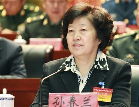 Sun Chunlan, then party chief of Fujian province, attends a meeting in Longyan, Fujian province December 28, 2009. China has promoted Sun, one of its most senior female leaders, to Communist Party chief of the northern port city of Tianjin, which the government is trying to turn into a global financial centre, state media said on November 21, 2012. Picture taken December 28, 2009. REUTERS/China Daily