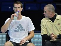 Andy Murray of Britain (L) speaks with his coach Ivan Lendl during a practice session ahead of the ATP tennis finals at the O2 Arena in London November 4, 2012. REUTERS/Toby Melville