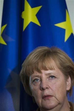 German Chancellor Angela Merkel stands in front of the European flag before a news conference after joint government talks with Poland at the Chancellery in Berlin November 14, 2012. REUTERS/Thomas Peter (GERMANY - Tags: POLITICS HEADSHOT)