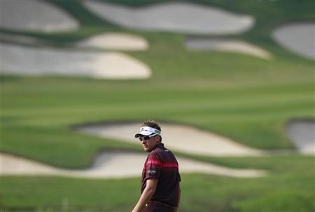 Ian Poulter of England looks back on the 15th fairway during the final day of the WGC-HSBC Champions Tournament at Mission Hills in the southern Chinese city of Dongguan November 4, 2012. REUTERS/Bobby Yip