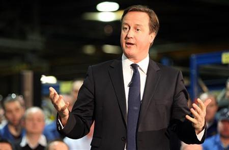 Britain's Prime Minister David Cameron answers questions at the Nacco Materials Handling factory near Portadown, Co Armagh, in northern Ireland November 20, 2012. REUTERS/Paul Faith/Pool