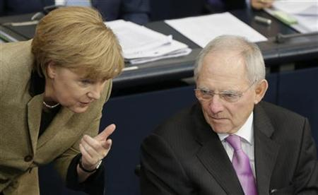 German Chancellor Angela Merkel chats with Finance Minister Wolfgang Schaeuble during a session of the German lower house of parliament Bundestag in Berlin November 21, 2012. REUTERS/Tobias Schwarz (GERMANY - Tags: POLITICS)