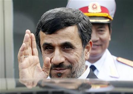 Iran's President Mahmoud Ahmadinejad waves after attending a wreath-laying ceremony at the mausoleum of late Vietnamese revolutionary leader Ho Chi Minh in Hanoi November 10, 2012. REUTERS/Kham