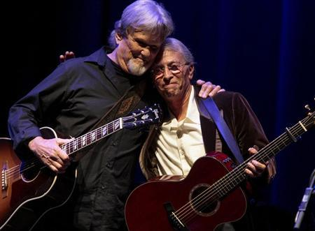 Kris Kristofferson (L) and Joel Rafael embraces each other after performing together during the Woody Guthrie Centennial Celebration Concert in Los Angeles, California, April 14, 2012. REUTERS/Bret Hartman