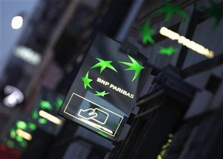 Illuminated signs light up at twilight outside the headquarters of the BNP Paribas bank in Paris January 30, 2012. REUTERS/Mal Langsdon
