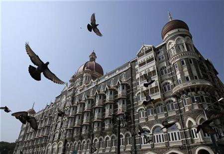 Pigeons fly outside the Taj Mahal Hotel, which was one of the targets of the 26/11 attacks, in Mumbai November 21, 2012. India secretly executed Mohammad Ajmal Kasab, the lone survivor of a Pakistan-based militant squad on Wednesday, just days before the fourth anniversary of an attack that killed 166 people in a rampage through the financial capital of Mumbai. REUTERS/Vivek Prakash