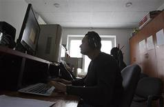 "A reporter works in an editing room of Stan.TV Internet portal in Almaty November 21, 2012. The Central Asian state of Kazakhstan has moved to ban two opposition movements critical of President Nursultan Nazarbayev and to close dozens of opposition media outlets for ""propagating extremism"". REUTERS/Shamil Zhumatov"