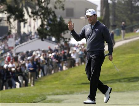 South Africa's Branden Grace reacts after his birdie on the third green during the first round for the 2012 U.S. Open golf championship on the Lake Course at the Olympic Club in San Francisco, California June 14, 2012. REUTERS/Jeff Haynes