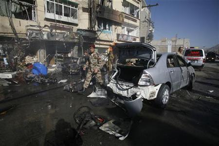 A paramilitary soldier walks at the site of a bomb attack in Quetta November 21, 2012. A bomb killed three soldiers in the Pakistani city of Quetta on Wednesday and security officials said the death toll was likely to rise. REUTERS/Naseer Ahmed