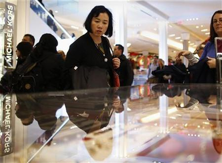 People shop inside Macy's department store as the busy holiday shopping season begins in New York, November 17, 2012. REUTERS/Carlo Allegri