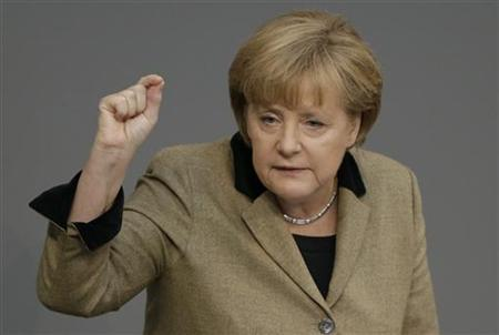 German Chancellor Angela Merkel makes a point during her speech at a session of the German lower house of parliament Bundestag in Berlin November 21, 2012. REUTERS/Tobias Schwarz (GERMANY - Tags: POLITICS)