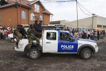 M23 rebels ride in a police truck in Goma November 21, 2012. REUTERS/James Akena (DEMOCRATIC REPUBLIC OF CONGO - Tags: CIVIL UNREST POLITICS)