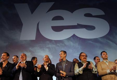Scotland's First Minister and leader of the Scottish National Party (SNP), Alex Salmond (3rd L), stands on the stage with supporters during the launch of the ''Yes Scotland'' campaign for an independent Scotland, in Edinburgh, Scotland May 25, 2012. REUTERS/David Moir