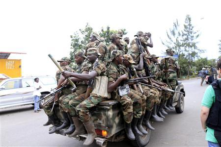 Congolese Revolution Army (CRA) rebels sit in a truck as they patrol a street in Goma in the eastern Democratic Republic of Congo (DRC), November 20, 2012, soon after the rebels captured the city from the government army. REUTERS/James Akena