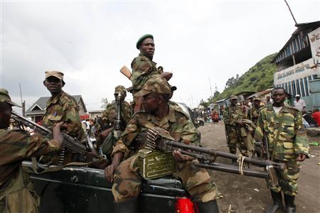 Congolese Revolution Army (CRA) rebels sit in a truck as they patrol a street in Sake, 25 km (15.5 miles) north of Goma city in the eastern Democratic Republic of Congo (DRC), November 21, 2012, soon after the rebels captured the town from the government army. REUTERS/James Akena