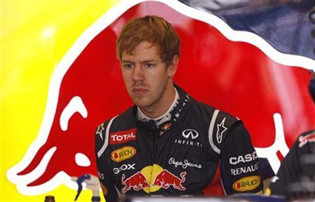 Red Bull Formula One driver Sebastian Vettel of Germany prepares for the second practice session of the U.S. F1 Grand Prix at the Circuit of the Americas in Austin, Texas November 16, 2012. REUTERS/Jim Young