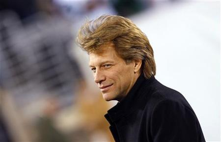 Musician Jon Bon Jovi walks on the field before the NFL football game between the New England Patriots and the New York Jets in East Rutherford, New Jersey, November 13, 2011. REUTERS/Mike Segar/Files