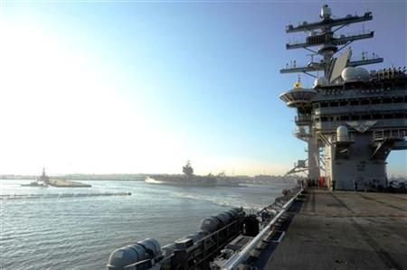 The aircraft carrier USS Dwight D. Eisenhower departs Naval Station Norfolk in this file photo taken August 25, 2011. REUTERS/Mass Communication Specialist 3rd Class Nathan Parde-US Navy/Handout