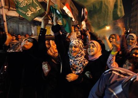 Palestinians celebrate what they say is a victory over Israel after an eight-day conflict in Gaza City November 21, 2012. REUTERS/Ahmed Zakot